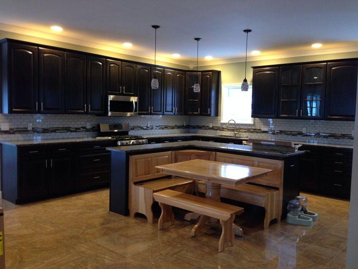 Caledonia granite, L shaped island and Dark brown cabinets on