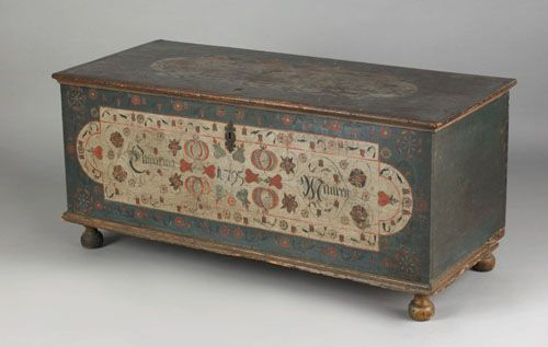 """Pook & Pook.  4/21/07.  Lot 753.  Estimated: $20K - $30K.  Realized: $46,800.  Lancaster County, PA. Painted dower chest dated 1795 by the Embroidery artist, the lid with typical sawtooth border panel surrounded by florettes over a case with a large ivory panel decorated with tulip vines, pomegranates, etc., inscribed """"Catharina Mauren"""", supported by bun feet, 22 3/4"""" h., 50"""" w. Illustrated in Fabian The Pennsylvania-German Decorated Chest fig. 223."""