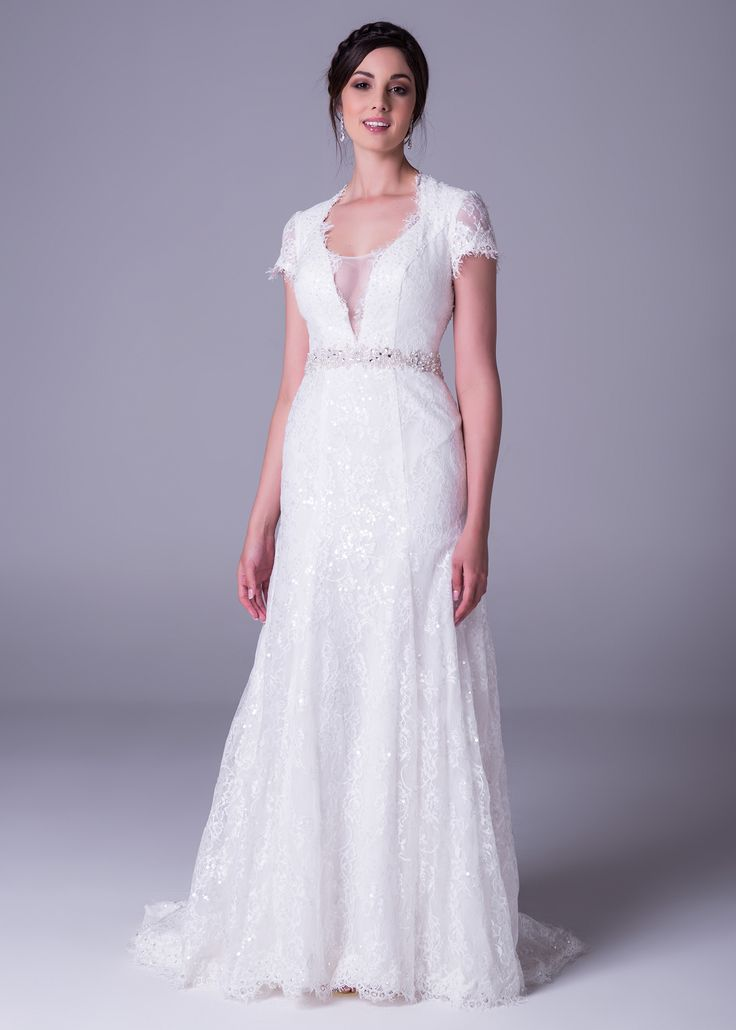Lace dress with sleeves and plunging neckline