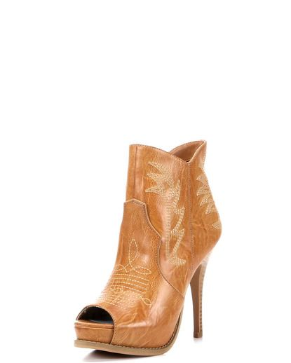 Call me crazy but I like these from the Miranda Lambert shoe line.  Women's Escapade Shoe - Cognac
