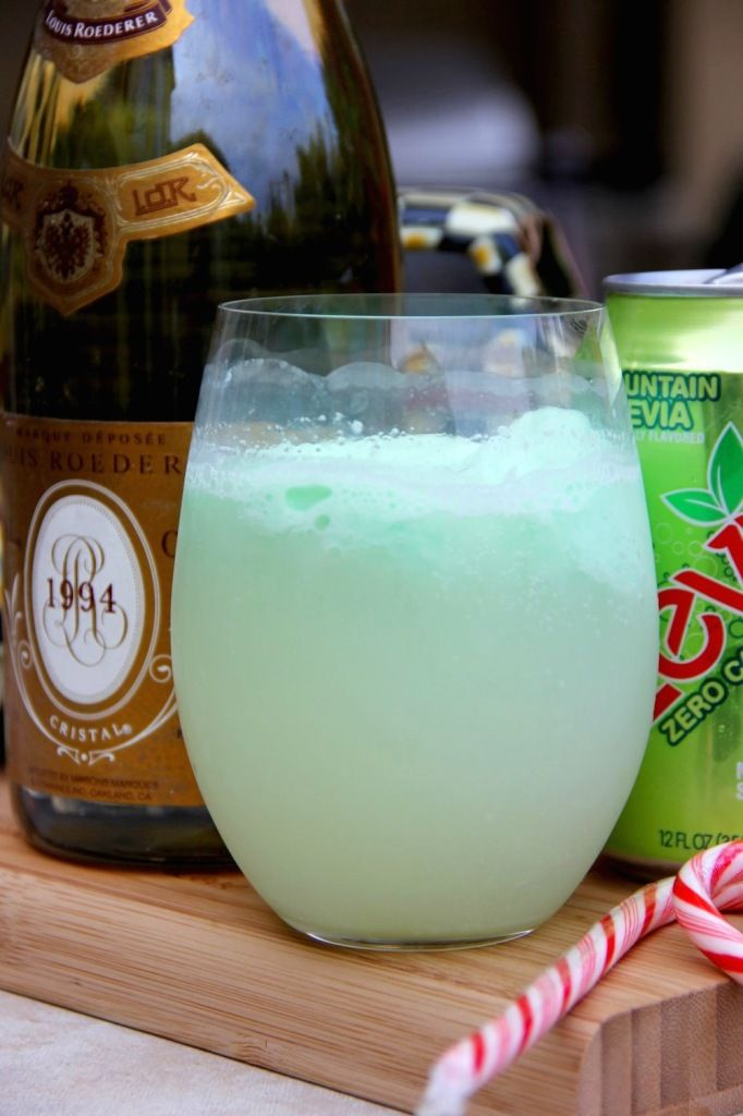 SKINNY GRINCH PUNCH!!! A must-have for your Christmas party this year. Only 100 calories per serving, this champagne/sherbet/Zevia-based drink is quickly becoming a holiday favorite!!