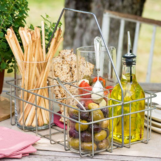 Keep party appetizers in one place with a repurposed wire caddy. More ways to organize food and drinks: http://www.bhg.com/party/birthday/themes/how-to-organize-outdoor-party-food-and-drinks/?socsrc=bhgpin051813appetizercaddy