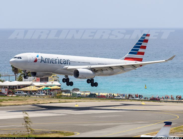 American new livery landing at St Maarten. Beautiful day, beautiful plane for beautiful airline in a beautiful place. Airbus A330-243 aircraft picture