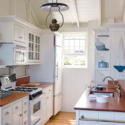 nautical-galley-kitchen: eggshell finish for walls and pearl for trim (here, all in Cloud White 967 by Benjamin Moore), pair with blues (Kensington Blue 840, Whipple Blue HC-152, Denin Wash 838), Mahogany countertops sealed with marine varnish and brushed nickel hardware