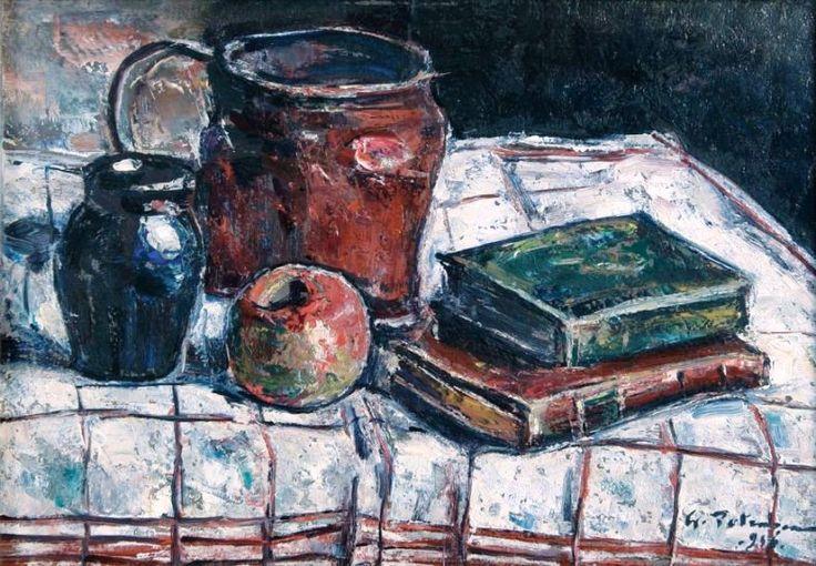 Natura moarta cu cărți pe o față de masă în carouri