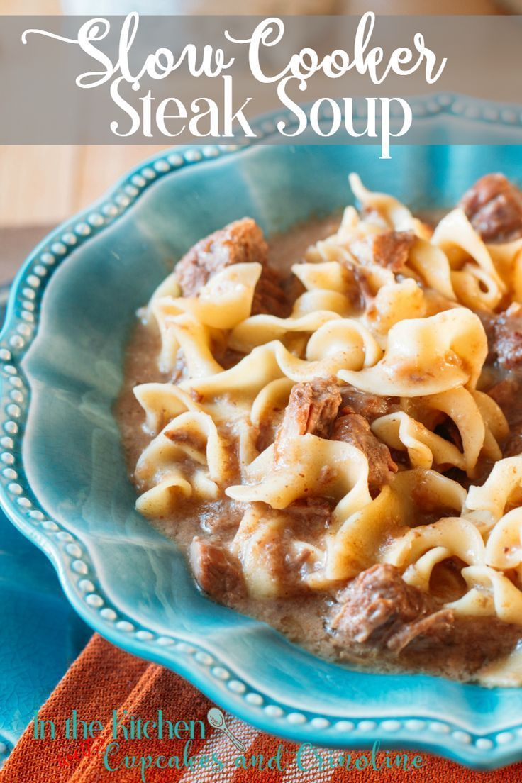 Hearty and delicious Slow Cooker Steak Soup with Noodles. Get the recipe at http://cupcakesandcrinoline.com