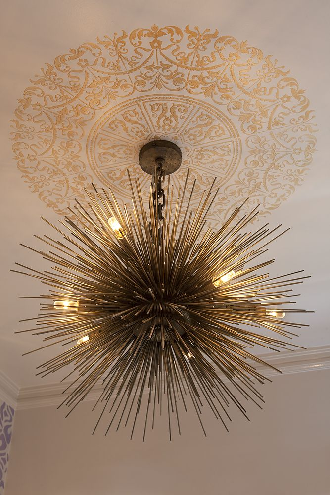 Cool chandelier...love the idea but probably not right for what we want.  Need something dramatic and big though.