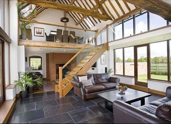 This upstair,downstair barn conversion looks amazing with its oak beams.