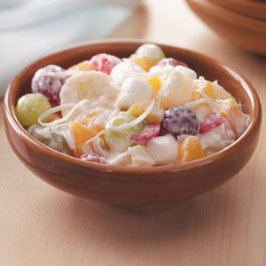 Quick Ambrosia Fruit Salad Recipe -I start this with plenty of fruit, add the yogurt for dressing, then mix in just enough marshmallows and coconut so it tastes like the fresh and creamy version I grew up with. It's a well-loved recipe in my home now. —Trisha Kruse, Eagle, Idaho