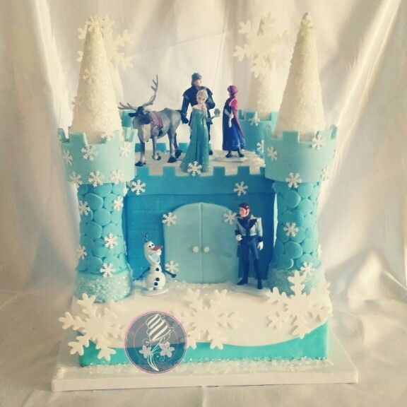 Bella's small cake for home. Small sheet cake and the castle made out of sugar cones and Rice Krispies covered in fondant.