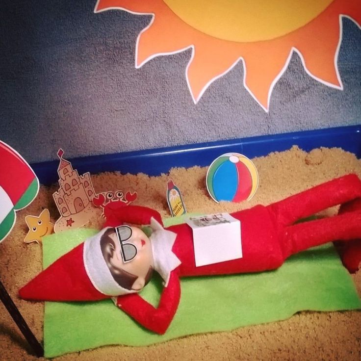 "Elf on the Shelf at the Beach!   When you're from the North Pole, sometimes you just need a break from the snow1 The props are printed on cardstock and trimmed. The tray is filled with brown sugar ""sand.""   Creative Elf on the Shelf, Funny Elf on the Shelf, Best Elf on the Shelf."