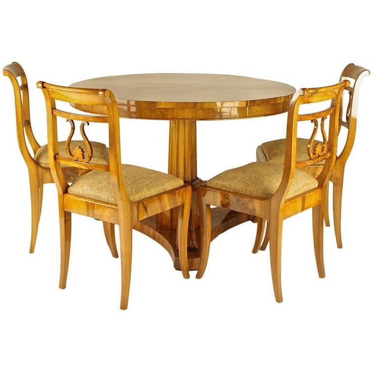 Early 19th Century Biedermeier Table with Four Side Chairs, Newly Upholstered | From a unique collection of antique and modern dining room sets at https://www.1stdibs.com/furniture/tables/dining-room-sets/
