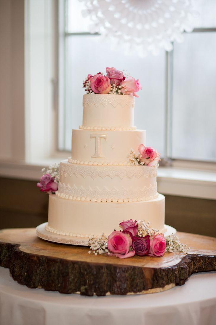 Four-Tier Monogrammed Cake with Roses | Kathleen Landwehrle Photography https://www.theknot.com/marketplace/kathleen-landwehrle-photography-stowe-vt-232094 | Schoolhouse Garden | Trillium Fine Desserts