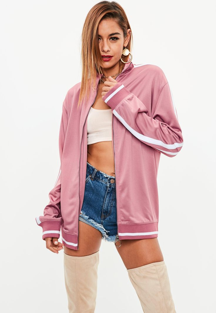 Oversized tracksuit top with a contrasting side stripe, long sleeves and pink hue.
