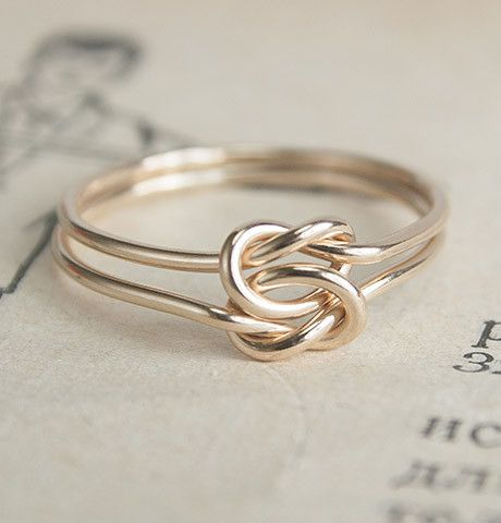"Here's another kind of knot that's quite appropriate for an engagement ring. The maker of this ring describes its meaning: ""This particular type, often called the 'true lover's knot', was a popular ring style for sailors separated from their beloved. It's made by interlocking two overhand knots in two parallel wires, so each one is flexible to move about the other, yet they're inseparable forever."