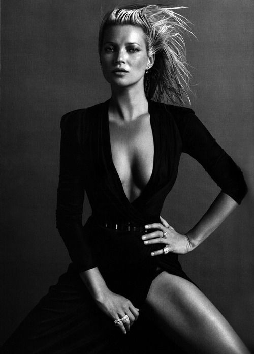 Beautiful black and white studio shot. Love the slick backed hair with wind and the leg popping out. Modeling. Kate Moss.