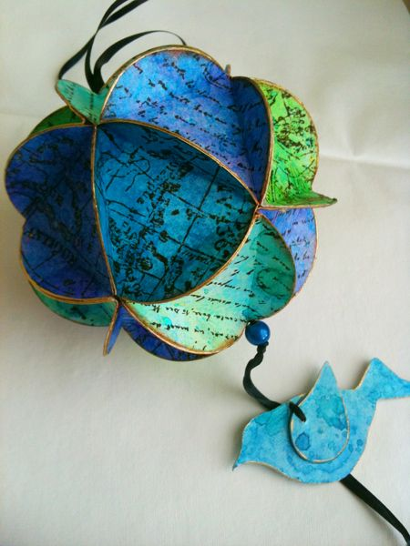 Paper Ball ornaments like this can be made from all kinds of recycled paper products. Image and instructions found at http://balzerdesigns.typepad.com/balzer_designs/2010/12/geodisic-paper-ornament.html#axzz1S5v2p4Rv