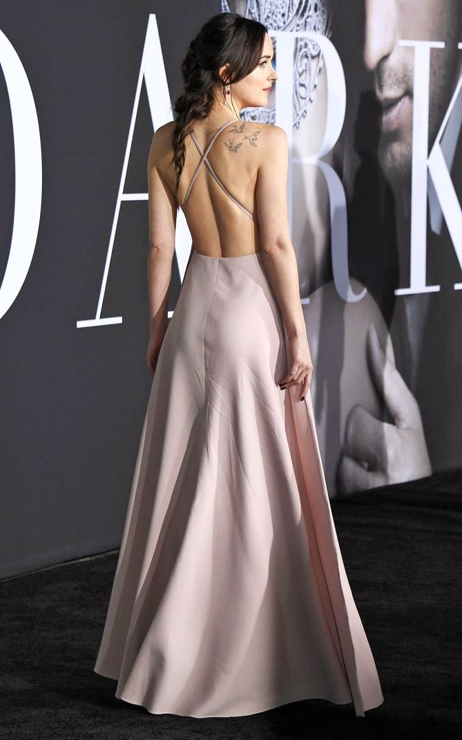 Dakota Johnson in a backless pink Valentino dress - click through for more dresses from the back