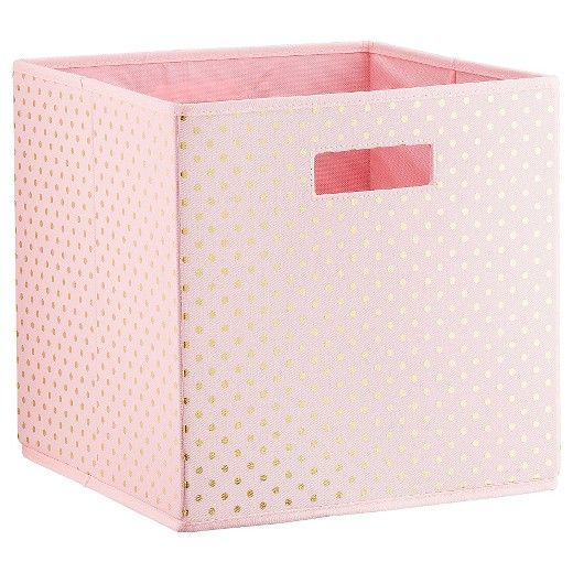 Corral all those toy dolls into one place with the Polka Dots KD Storage Bin in Pink from Pillowfort. This storage cube has a cut-out handle for easy carrying and gold polka dots that add shine.