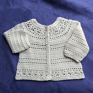 Featuring eye-catching floral lace detailing and simple lacy stripes, Gina makes a sweet looking baby/child cardigan. The little cardigan is constructed seamlessly in one piece from the top down. It is equally beautiful with long or short sleeves – either way, your little one will look undeniably adorable in this little lovely piece.