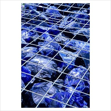 GAP Photos - Garden & Plant Picture Library - Metal gabion cube filled with large chucks of blue glass. WRAP 'The Recycled Garden', RHS Hampton Court Flower Show - GAP Photos - Specialising in horticultural photography