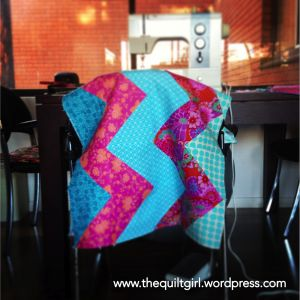 Pink and blue chevro quilt is halfway done
