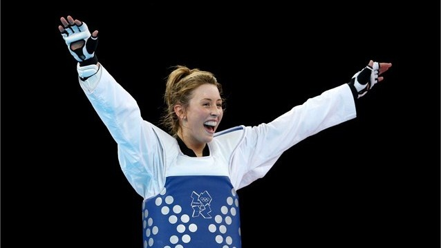 Jade Jones of Great Britain celebrates defeating Yuzhuo Hou of China during the Women's -57kg Taekwondo gold medal final on Day 13 of the London 2012 Olympic Games at ExCeL