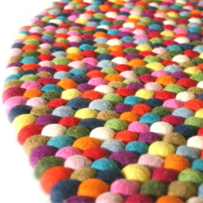 Would love one of these for the kids play area....  Little Lamb Freckle Rug by Australian design company Down To The Woods.
