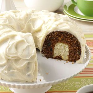 "Surprise Carrot Cake Recipe -A cousin gave me this carrot cake recipe. It's a wonderful potluck pleaser with its ""surprise"" cream cheese center. My husband and our two young children love it, too! —Lisa Bowen, Little Britian, Ontario"