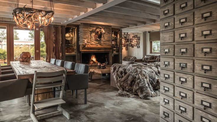 Great living space with an amazing atmosphere. Designed by the one and only owner of Global Moodmakers, Robert van der Linde. #nature #rustic #brown #wood #stone #wonderfull #country #style #warmth #great #atmosphere #special #design #architecture #interior #landscaping #view