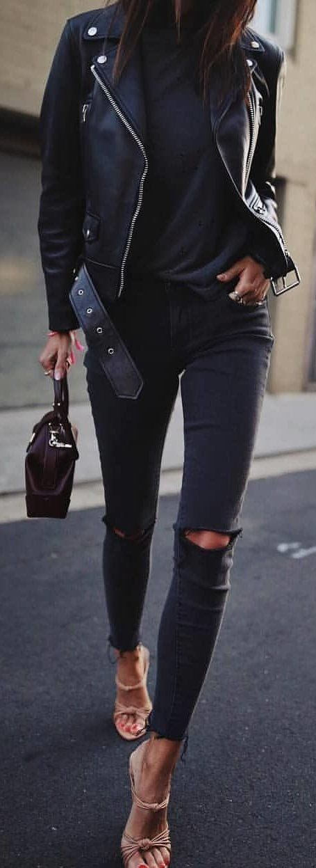 #spring #outfits woman wearing black denim pants and leather full-zip jacket holding leather handbag. Pic by @milano_streetstyle