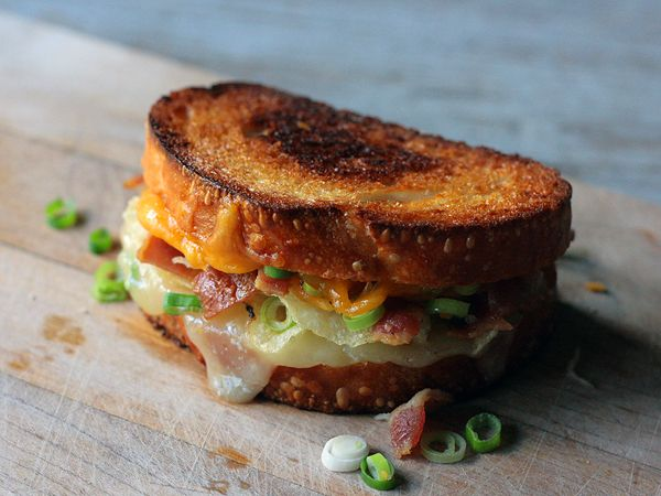 Loaded Baked Potato Grilled Cheese Sandwich... Only I would use crumble baked potato and cheddar cheese instead of chips and Mozzarella, and serve with a side of sour cream :)