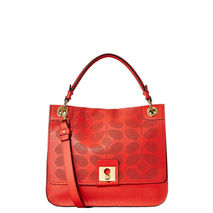 Orla Kiely and red: SOLD    Soft grainy leather unlined bag with punched Sixties Stem detail to front. Large metal clip to close. Gold colored hardware. Small back pocket. Adjustable, detachable long leather strap in addition to top handle for the bag to be worn across the body (max 44in). Inside details include leather zip pocket and elastic key chain. Navy colored coating to interior.    This product is made from high quality leather. This ...