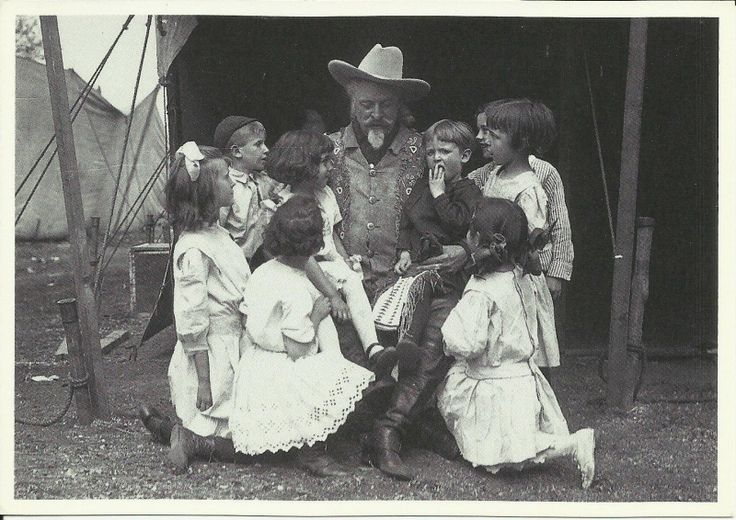 "Frontiersman, scout, Pony Express Rider and showman William Frederick ""Buffalo Bill"" Cody (1846-1917) in a tent on the grounds of his Wild West Show, spinning yarns for the youngsters.  Date Unknown"