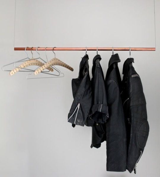 Hallow pole strung with wire attached to ceiling. DIY clothing rack. Figure out how to keep pole level
