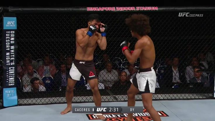 BIG left hand drops Dy! Alex Caceres gets the TKO stoppage! #UFCSingapore