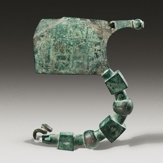 Greek plate fibula with engraved decoration, 750-700 B.C. 14.5 cm long. Private collection