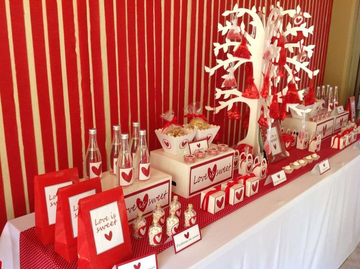 Lovely dessert table and backdrop at a Valentine's Day party!  See more party planning ideas at CatchMyParty.com!