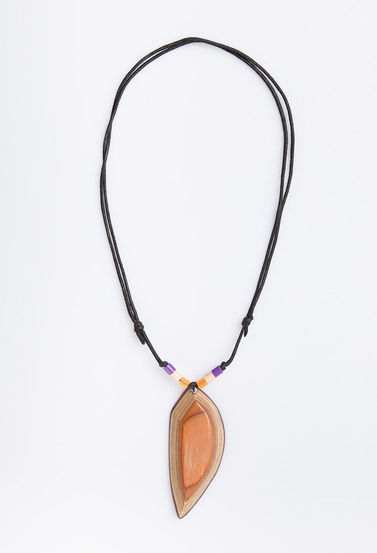 Sharp Mejiku Necklace by Kabau. The series of mejiku necklace that mostly has variety of colors at the necklace. Handcrafted with care and made by passion from mapplewood as material in brown color from reused skateboard. Unique design with touch of purple, white and yellow beads also with adjustable stripes black strings.  http://www.zocko.com/z/JJymD