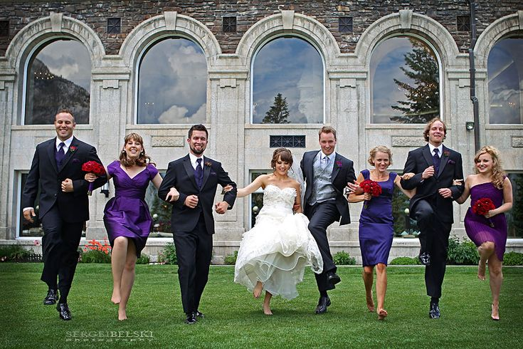 Wedding party fun on the lawn of the Fairmont Banff Springs; purple and red wedding (Photo credit: Sergei Belski)