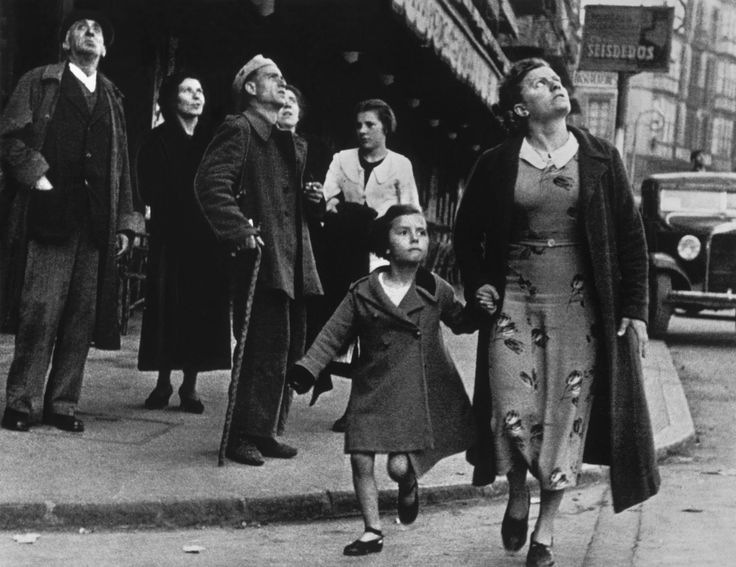 Robert Capa  - Running for shelter during the air raids in the Basque region, Bilbao, Spain, 1937