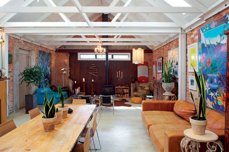 This former mechanic's workshop has been transformed by architect Mark Smith into a family home with a large open-plan living area.