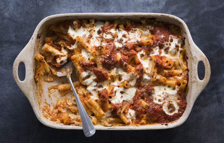 We+know+ricotta+is+a+traditional+addition+to+baked+ziti,+but+it+has+a+tendency+to+get+dry+and+grainy+when+baked.+Our+update+uses+a+creamy+Parmesan+béchamel,+in+addition+to+a+tangy+tomato+sauce,+which+together+make+for+a+super+flavorful+finished+dish—that+won't+dry+out+in+the+oven.+This+is+part+of+BA's+Best,+a+collection+of+our+essential+recipes.