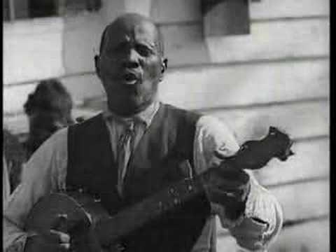 """Uncle John Scruggs from the 1928 movie """"Times Ain't Like they Used to Be"""" doing an old minstrel song """"Little Log Cabin in the Lane.""""  The black banjo tradition had already largely died out by the 20s so this is an exceedingly rare glimpse into the past at the earliest form of ragtime."""