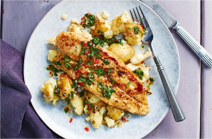 A fish supper for two ready in just 15 minutes, try this delicious recipe for basa fillets with garlic potatoes. Find more Fish recipes at Tesco Real Food.