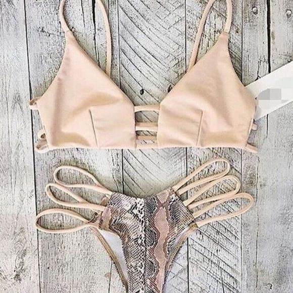 L & M Brazilian snakeskin cheeky bikini ✨ Brazilian sexy snakeskin cheeky bikini; unbranded. *WHAT YOU SEE IN THE LAST PICTURE IS WHAT YOU ARE RECEIVING - I consider offers!! If you would like a size that is not listed, please specify in the comments & I will give you an estimated ship date Swim Bikinis