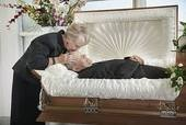 This is love. I saw my Mom kiss my Dad in his coffin at 8 years old. It is normal to say goodbye and for a spouse to kiss them one last time.