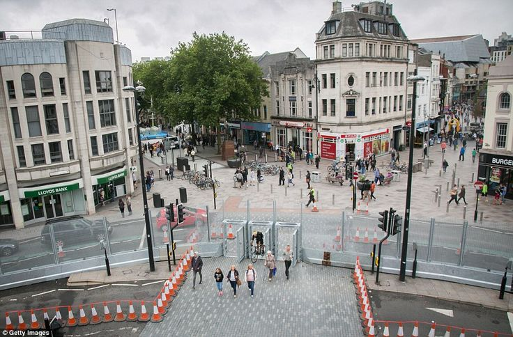 Cardiff city centre resembles a high security ¿prison¿ with its 10 miles of fencing - dubbed the ¿ring of steel¿ - put up ahead of the Nato ...