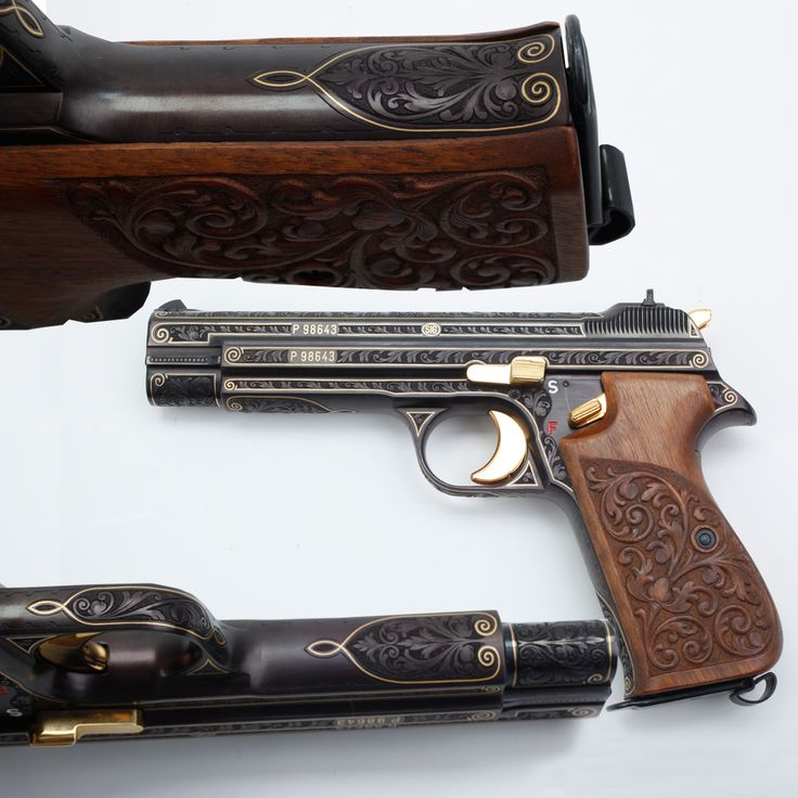 Sig P210 9mm Semi-Automatic Pistol: This pistol presents some of the best repetitive floral engraving curves we've seen recently. It's especially nice to see how the engraver worked with the contours of the receiver to also elegantly highlight and outline features in flowing gold lines. Even the walnut grip panels on this pistol follow the floral motif repeating on the slide and frame. For those precious metal enthusiasts – the hammer, trigger, slide release & safety lever are all…
