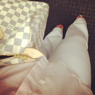 Fresh! White pants, baby pink top and Louis Vuitton handbag
